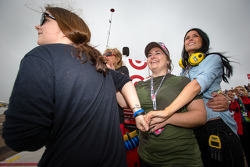 Kirsten Dee, girlfriend of James Hinchcliffe, watches the end of the race with Holly Wheldon, James' mom Arlene Hinchcliffe, James' sister Rebecca Hinchcliffe