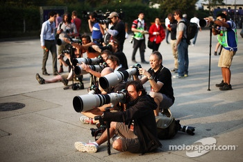 Photographers shooting in the paddock