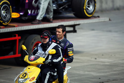 Mark Webber, Red Bull Racing returns to the pits after stopping during qualifying