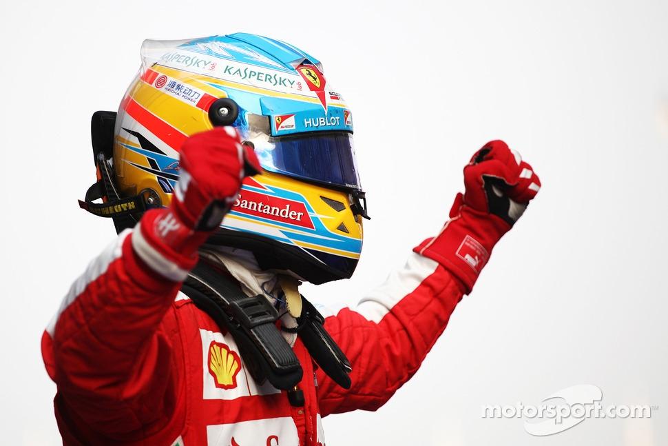 Race winner Fernando Alonso, Ferrari F138 celebrates in parc ferme