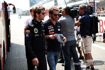 Romain Grosjean, Lotus F1 Team and Jean-Eric Vergne, Scuderia Toro Rosso on the drivers parade