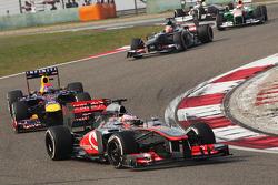 Jenson Button, McLaren MP4-28 leads Sebastian Vettel, Red Bull Racing RB9