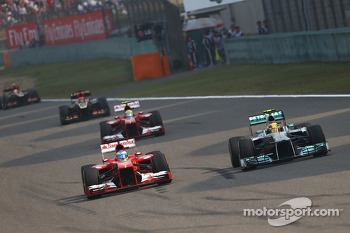 Fernando Alonso, Ferrari F138 and Lewis Hamilton, Mercedes AMG F1 W04 battle for the lead of the race