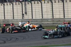 Kimi Raikkonen, Lotus F1 Team and Paul di Resta, Force India Formula One Team