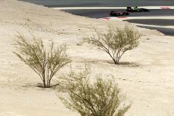 Charles Pic, Caterham CT03 leads Kimi Raikkonen, Lotus F1 E21