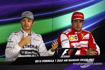 (L to R): Pole sitter Nico Rosberg, Mercedes AMG F1 and Fernando Alonso, Ferrari in the FIA Press Conference