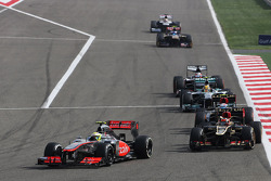 Sergio Perez, McLaren MP4-28 leads Kimi Raikkonen, Lotus F1 E21