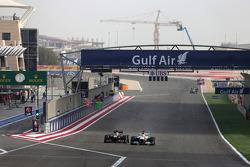 Romain Grosjean, Lotus F1 Team and Paul di Resta, Force India Formula One Team