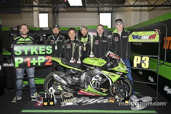 The Kawasaki team celebrate's Tom Sykes' weekend