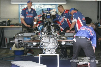 A.J. Foyt Enterprises crew members rebuild Conor Daly's car