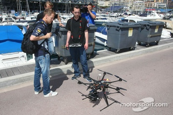 Sebastian Vettel, Red Bull Racing looks at a motorised helicopter