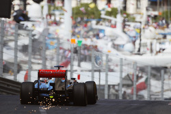 F1: Jenson Button, McLaren MP4-28 sparks as he exits the tunnel