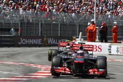Jenson Button, McLaren MP4-28 leads team mate Sergio Perez, McLaren MP4-28