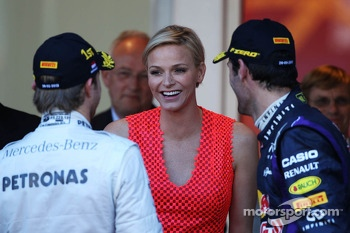 (L to R): Nico Rosberg, Mercedes AMG F1 with Princess Charlene of Monaco,  and Mark Webber, Red Bull Racing on the podium