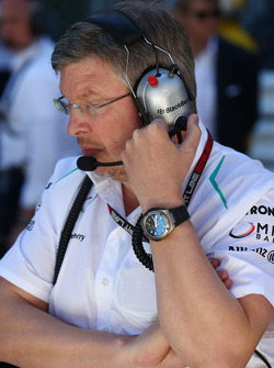 Ross Brawn, Mercedes AMG F1 Team Principal on the grid as the race is stopped