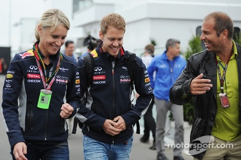 (L to R): Britta Roeske, Red Bull Racing Press Officer with Sebastian Vettel, Red Bull Racing and Kai Ebel, RTL TV Presenter