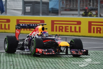 Sebastian Vettel, Red Bull Racing RB9 runs wide at the final chicane