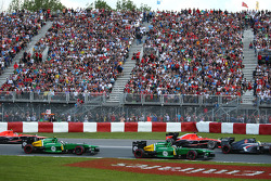 Charles Pic, Caterham CT03 leads Giedo van der Garde, Caterham CT03 at the start of the race