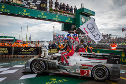 Race winners Tom Kristensen, Allan McNish and Loic Duval enter parc fermé