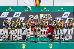 LMP1 podium: class and overall winners Tom Kristensen, Allan McNish, Loic Duval, second place Anthony Davidson, Stéphane Sarrazin, Sébastien Buemi, third place Marc Gene, Oliver Jarvis, Lucas di Grassi
