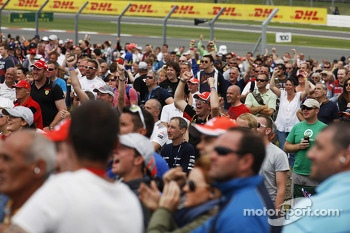 Fans celebrate as Lewis Hamilton, Mercedes AMG F1 takes pole position