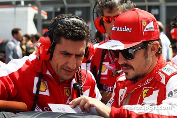 Fernando Alonso Ferrari on the grid with Andrea Stella Ferrari Race Engineer