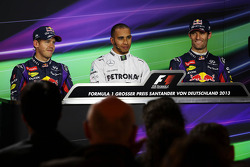 The top three qualifiers in the FIA Press Conference: Sebastian Vettel, Red Bull Racing, second; Lewis Hamilton, Mercedes AMG F1, pole position; Mark Webber, Red Bull Racing, third.
