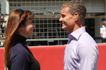 (L to R): Suzi Perry, BBC F1 Presenter with David Coulthard, Red Bull Racing and Scuderia Toro Advisor / BBC Television Commentator