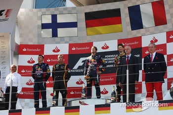 The podium, Kimi Raikkonen, Lotus F1 Team, second; Sebastian Vettel, Red Bull Racing, race winner; Romain Grosjean, Lotus F1 Team, third.