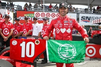 Photographers gather for Dario Franchitti pole celebration