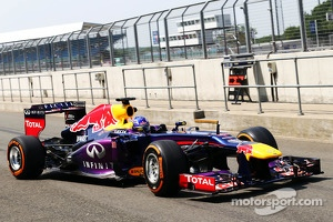 Daniel Ricciardo, Red Bull Racing RB9 Test Driver leaves the pits