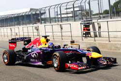 Daniel Ricciardo, Red Bull Racing RB9 Test Driver leaves the pits
