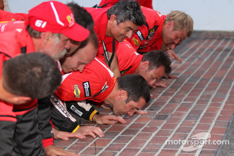 GT winners Max Papis and Jeff Segal kiss the yard of bricks