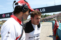 Jules Bianchi, Marussia F1 Team with Marc Hynes, Marussia F1 Team Driver Coach on the grid