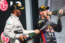 Lewis Hamilton, Mercedes AMG F1 and Sebastian Vettel, Red Bull Racing RB9
