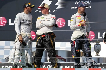 The podium: race winner Lewis Hamilton, Mercedes AMG F1; Kimi Raikkonen, Lotus F1 Team, second; and Sebastian Vettel, Red Bull Racing third