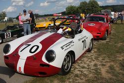 Race Cars line up fir the parade into Elkhart Lake. #70  1961  Porsche 356B: Vic Sirmants