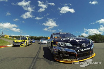 Polesitter Marcos Ambrose and Clint Bowyer follow the safety car during pace laps