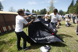Timo Glock and Bruno Spengler build a tent