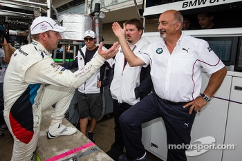 GT pole winner Joey Hand celebrates with Bobby Rahal