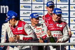 LMP1 podium: champagne for Loic Duval, Stéphane Sarrazin, Allan McNish and Benoit Tréluyer
