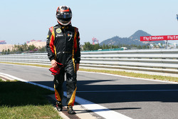 Kimi Raikkonen, Lotus F1 Team walks back to the pits after he crashed at the end of the first practice session
