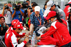 Felipe Massa, Ferrari and team mate Fernando Alonso, Ferrari sign autographs for the fans