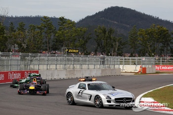 Sebastian Vettel, Red Bull Racing RB9 leads behind the FIA Safety Car