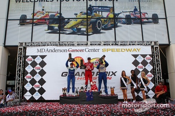Race winner Scott Dixon, second place Simona de Silvestro, third place Justin Wilson