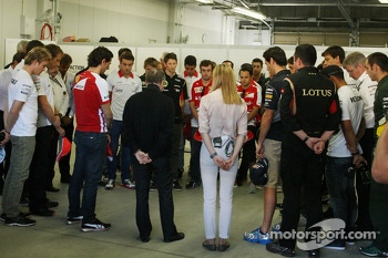 Jean Todt, FIA President, drivers, and key team personnel, observe a minute's silence for Maria De Villota