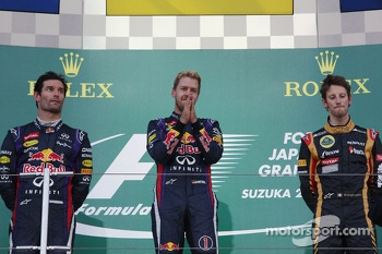 The podium: Mark Webber, Red Bull Racing, second; Sebastian Vettel, Red Bull Racing, race winner; Romain Grosjean, Lotus F1 Team, third