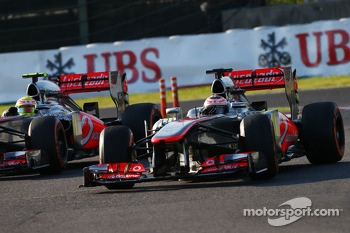 Sergio Perez, McLaren MP4-28 and Jenson Button, McLaren MP4-28