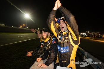 Nick Heidfeld and Nicolas Prost celebrate as Neel Jani takes the checkered flag