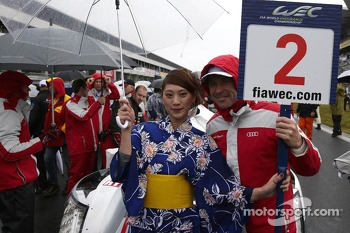 Tom Kristensen with a grid girl